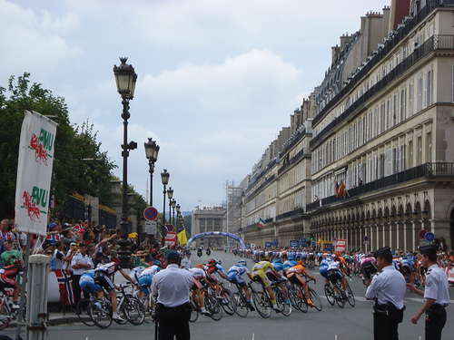 The Tour De France peloton hits the Rue De Rivoli on the finishing circuit in central Paris.