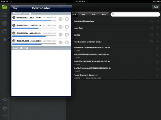 Left side with tab open, it shows the progress of files I downloaded with cancel and pause buttons.