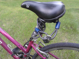 Running your bike chain through the seat bracket keeps your seat from being taken and keeps your lock handy.