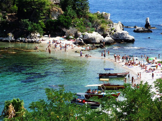 Isola Bella, a small island near Taormina, Sicily, southern Italy. A popular destination for sunbathers.