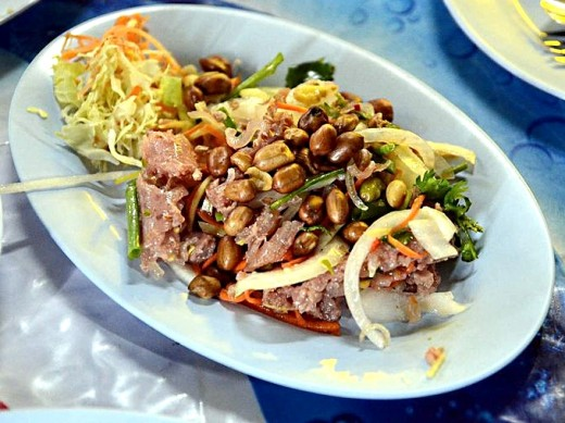Thai salad made from fermented raw pork and sticky rice (naem) with peanuts and herbs.
