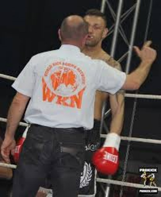 A referee issues a standing 8 count during an amateur match. An eight count is issued for the boxers safety because it gives the ref a chance to evaluate the stricken boxer.