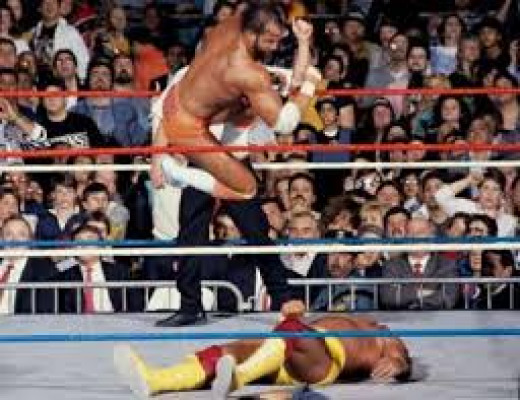 Randy Savage leaps off the top rope onto Hulk Hogan. The Macho Man was great at leaping high into the air and landing on opponents inside and outside the ring.
