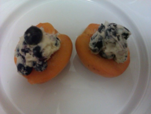 This blueberry mascarpone cream was chilled served in room temperature fresh apricot halves. For a lighter texture and taste, use blender or whisk and whip mascarpone with sugar before adding the fresh blueberries.