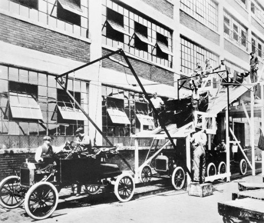 Henry Ford came up with the assembly line where each worker was tasked with a specific repetitive job that combined, resulted in a complete complex commodity.