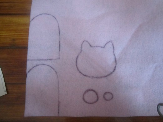 Trace your body template and draw your shapes out on to the felt using a pencil or pen.