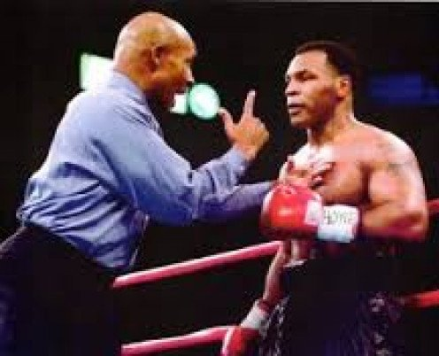 Referee Richard Steele admonishes Mike Tyson during a bout. He has been involved in a few controversies during his tenure as a referee.