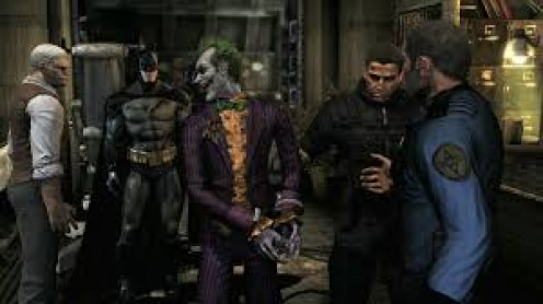 Batman ensures that The Joker is in custody in ARKHAM Asylum.