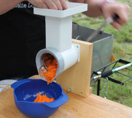 Hand crank Family Grain Mill system with optional food chopper.