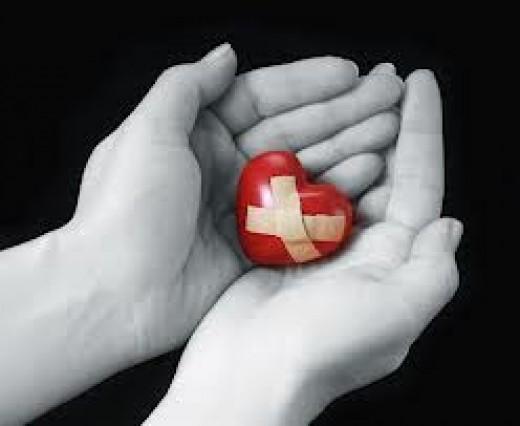 Broken heart in hands.