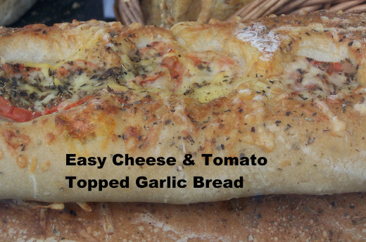 Make Garlic and Cheese Bread From Scratch in Under an Hour: Cheese and Tomato Topped Garlic Bread.