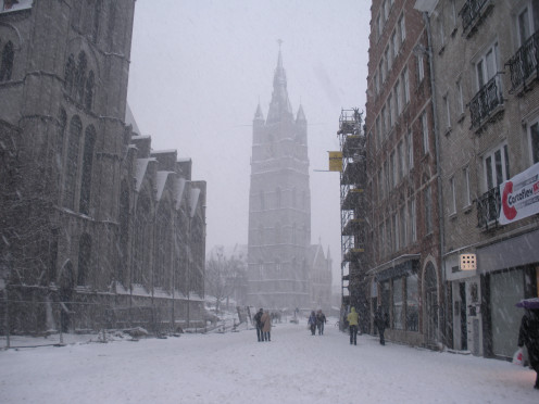 The belfry of Ghent (Belgium) as seen from the Cataloniëstraat during a blizzard.