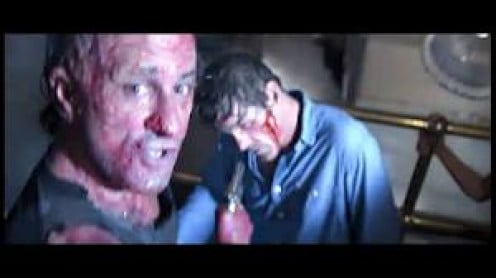 Max Cady (Robert De Niro) is burned but, unbowed as he attacks in Cape Fear.