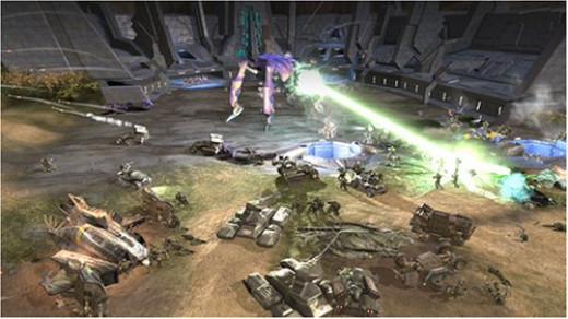 A covenant army battles it out with UNSC forces on Halo Wars the game.