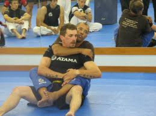 Royce Gracie is seen here teaching Gracie Jui Jitsu to a class. His Brazilian combat is deadly and a great defensive skill.