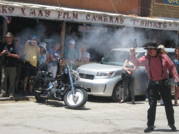 """The only picture I was able to get of the """"smoke"""" from the gunfire. It's hard to capture that right moment! This was during the staged gunfight that happens on the streets of Oatman every day about high noon."""