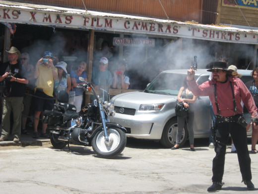 "The only picture I was able to get of the ""smoke"" from the gunfire. It's hard to capture that right moment! This was during the staged gunfight that happens on the streets of Oatman every day about high noon."