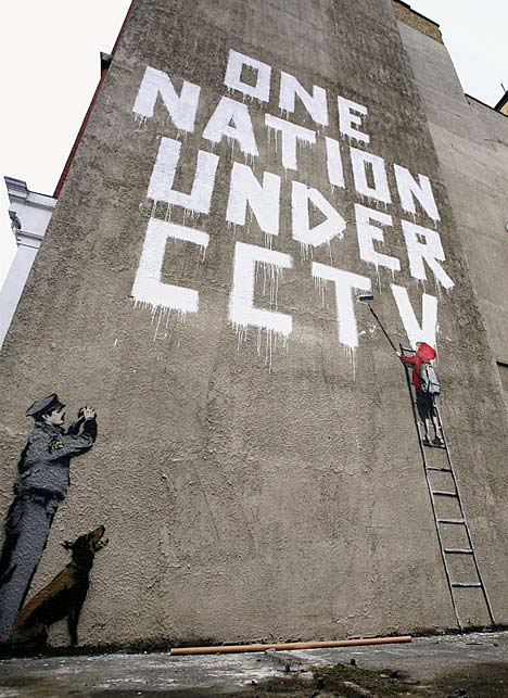 Graffiti by anonymous British street artist Banksy.