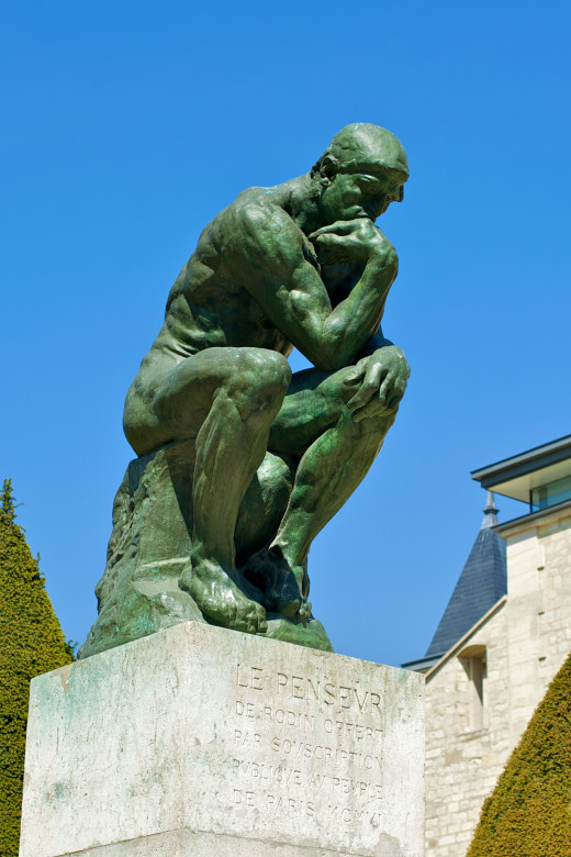 The Thinker, a powerfully simple piece of sculpture by Auguste Rodin, cast in bronze.