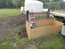 This is the Sump Pit box it is two sheets of treated 1/2 inch plywood. and four ten foot 4x4s. It is four foot three inches three sides are 4ft and the side where the lid will be attached is three inches taller so the rain will run off easily.