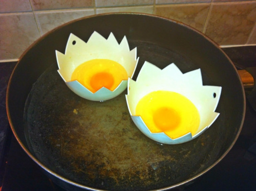 Put eggs into poachers and poachers into the pan