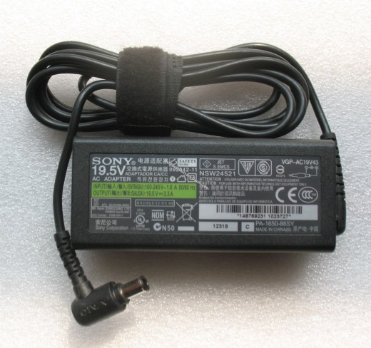A power supply (charger) made by Sony. The tag clearly states the input and output voltage and current, along with other identification serial numbers and country of origin.
