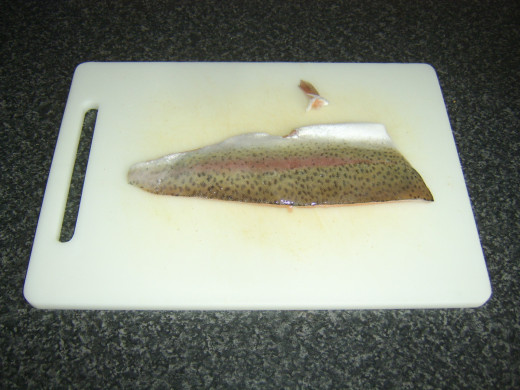 Fins are snipped from rainbow trout fillets