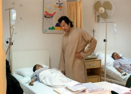 Imran khan the founder of SKM Hospital busy with  patient.