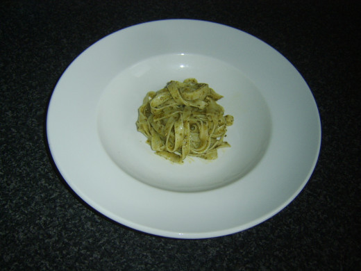 Linguine with drained pesto sauce is plated