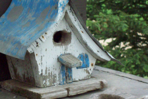 My brother Rusty made this birdhouse when he was in high school in the 70s. We lost Rusty in 2003 to cancer.  This has become a family heirloom for me.