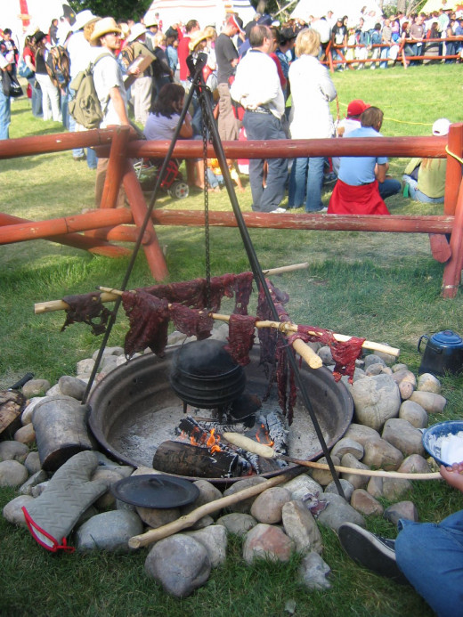 Traditional method of drying meat for pemmican demonstrated at Calgary Stampede