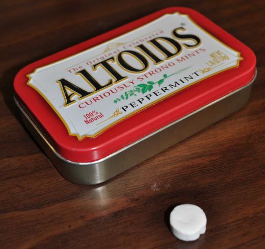 an altoid and its tin