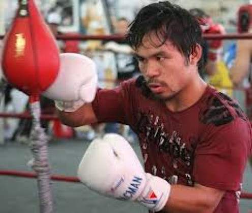 8 division world champion Manny Pacquiao works the double end bag to help him stay sharp and accurate.