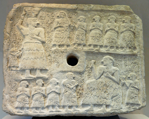 A Sumerian relief showing giants figures.  Are they giants or merely the main characters?