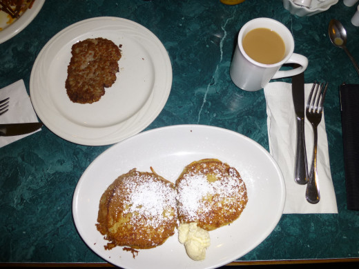 Stuffed Balboa French Toast with a sausage patty and of course my cup of coffee!
