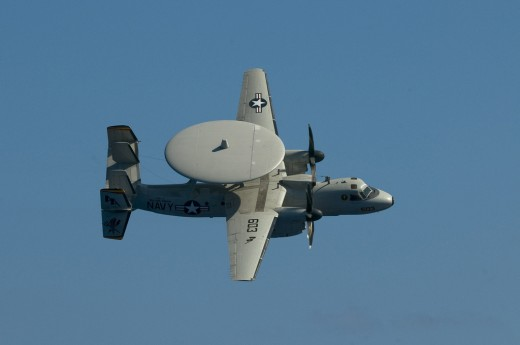 An E2-C Hawkeye.  This is not the same as I recall seeing as a child (the disk seemed a lot bigger), but it is close enough to explain the misunderstanding.