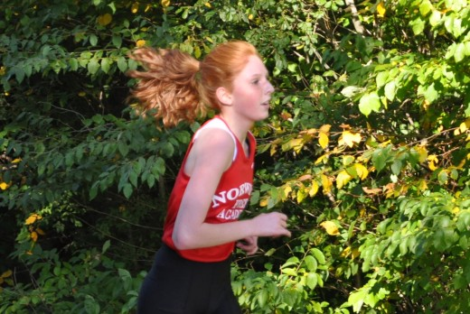 Michaela running a cross country race in high school in spite of suffering with Juvenile Rheumatoid Arthritis.