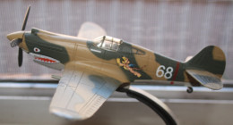 ANOTHER VIEW OF A MODEL OF A P-40 PAINTED TO KILL AS A FLYING TIGER.