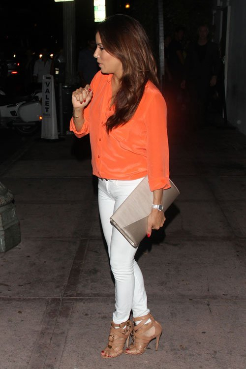 Eva Longoria leaving Beso restaurant wearing skinny white jeans and towering high heels. I never get tired of seeing her in white jeans and heels.