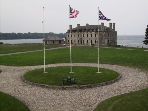 French Castle and parade ground at Old Ft  Niagara     with flags of three nations (French Flag of Louis XIV, British and American).