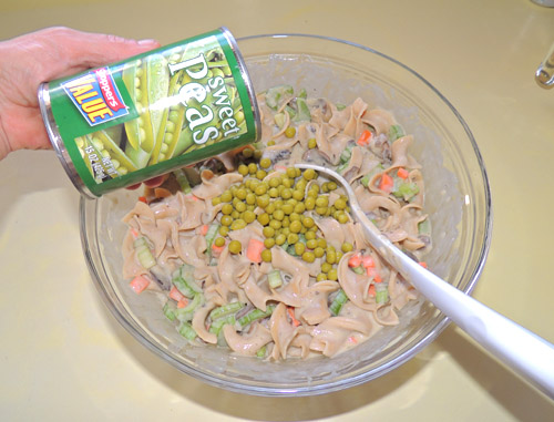 add peas. Stir. Salt & pepper as desired