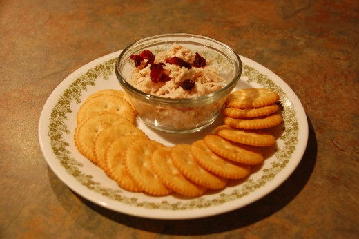 Easy chicken salad, topped with dried cranberries and served on crackers, yumm!
