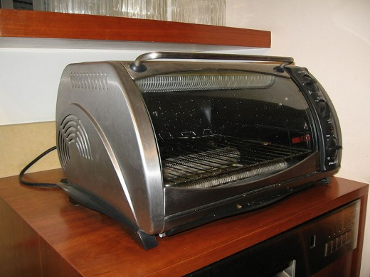 Toaster ovens are relatively small and can do about a million things, except for washing the dishes.