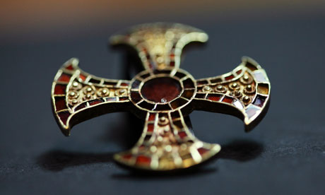 This cross of gold and garnet was found in a Anglo-Saxon girls grave, she was buried around 1,300 years ago