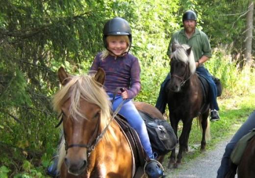Cute kids riding a horse.