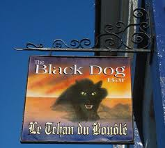 A pub sign associated with the Black Dog of Bouley Bay, looks a bit like the sign for The Slaughtered Lamb from the film American Werewolf In London!