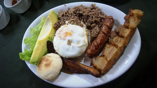 Bandeja Paisa (Its actually bigger than what it looks here) Avocado,sweet plantains,ground beef, red beans (not shown),rice, pan de bono (bread), chorizo, pork rinds,tortilla (not shown)