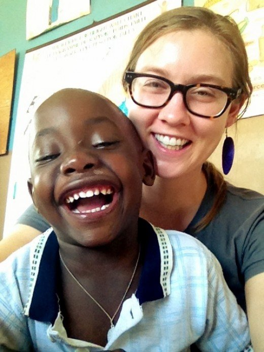 Claire and a young Rwandan boy she lives with and takes care of.