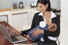 Woman breastfeeding her child at work