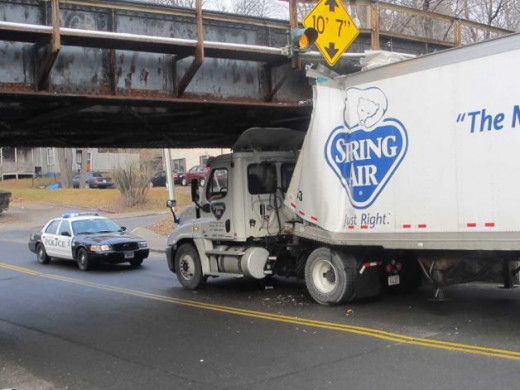 A tractor trailer crashed into the West Street Bridge on Wednesday, Feb. 15, 2012.